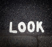 Look sign on the street Stock Images