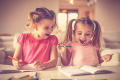 Look sis what I draw. Little girls. royalty free stock photos