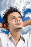 Look at sky. Man on white background looking at sky and think something positively Royalty Free Stock Photo