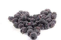 Look at this A stack of fresh sweet blackberry`s in the shape of something oh i know a hart Royalty Free Stock Images