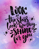 Look at the stars, look how they shine for you. Inspirational quote at violet and pink watercolor background Stock Images