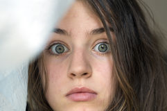 Look of a surprised girl with blue eyes Stock Photos