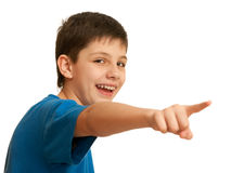 Look there!. A pointing forward laughing boy; isolated on the white background Royalty Free Stock Image
