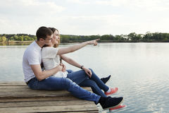 Look there! Get fun!. Young couple laughing. She shows at sonething and they laugh. Get fun Royalty Free Stock Images