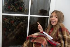 Free Look There. Happy Small Reader Point Finger At Window. Small Girl Enjoy Reading Christmas Story Wrapped In Plaid. Small Stock Image - 134016421