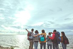 Group of folks looking at sun and the sea royalty free stock images