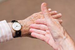 Look at the time !. Elderly man pointing at his watch, showing the time Royalty Free Stock Photos