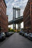Look trough the hole of the Manhattan Bridge stock photos