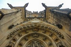 Look up carved archway entrance detail of the elaborately carved tympanum of Saint Vitus Cathedral in Prague royalty free stock photography