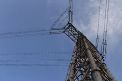 Look up in the corner of transmission line tower Royalty Free Stock Photo