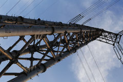 Look up in the corner of transmission line tower Royalty Free Stock Images