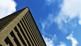 Look up multistory building against blue sky Stock Photos
