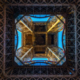 Look up from one of the platforms of the illuminated Eiffel Tower in Paris, France. Paris, France - October 16, 2016: look up from one of the platforms of the Royalty Free Stock Image