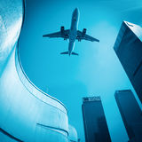 Look up to the airplane and see modern buildings skyline Stock Photos