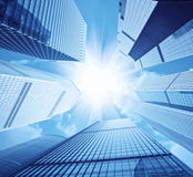 look up to modern skyscrapers and sun glare Stock Image