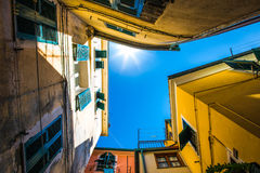 Look up view of famous travel landmark destination Riomaggiore colorful houses along street,small mediterranean old sea Royalty Free Stock Photos