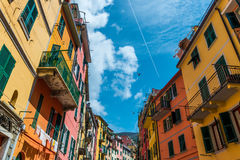 Look up view of famous travel landmark destination Riomaggiore colorful houses along street,small mediterranean old sea Royalty Free Stock Image