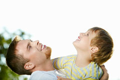 Look upward!. Father and small little son in embraces look in the sky stock image