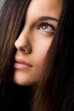 Look upwards. Part of face of young female with dark hair looking upwards Stock Photo