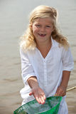 Look what I caught. Young girl showing the shrimp she caught from the sea Royalty Free Stock Photos