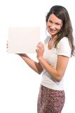 Look what I have!. Young woman in white shirt is holding a blank sign stock images
