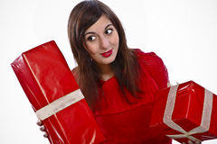 Look What I've Got For Christmas!. Pretty Brunette Woman Showing Some Christmas Presents stock photography
