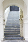 Look through the white arch. On the stairs Stock Photography