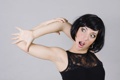 Look who's there. Pretty women stretching and surprise to see her hand Stock Photography