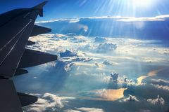 Airplain wing and the Earth. A look through the window of the tsillet - the earth, the river, the clouds Stock Photography