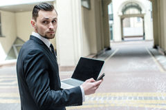 Look at the work done. Young businessman receives a call from a Royalty Free Stock Images