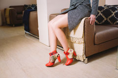 Lookbook woman`s legs in red leather boots in the interior. Lookbook woman`s legs in red leather boots handmade in the interior Stock Image
