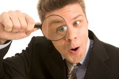 Looking-for. Portrait of businessman looking through a magnifying glass Stock Image