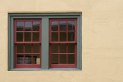 Looking In. Close up of double hung office windows, looking in from the outside royalty free stock photo