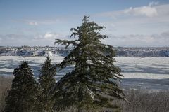 Ice Floes in the Saint Lawrence River near Quebec City, Canada. Looking access the Saint Lawrence River toward Laval, Quebec, in Canada on a cold day in the royalty free stock photos