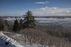 Ice in the Saint Lawrence River near Quebec City, Canada. Looking access the Saint Lawrence River toward Laval, Quebec, in Canada on a cold day in the winter royalty free stock image