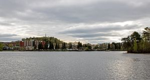 Shawinigan, Quebec, Canada And The Saint Maurice River. Looking acoss the Saint Maurice River from the Cite de l`Energie at Shawinigan, Quebec, Canada royalty free stock image