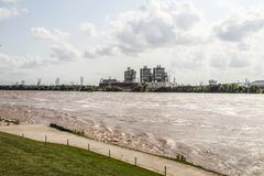 Looking across the Arkansas River at flood stage at the Public Service Company on the opposite shore. Tulsa USA 5 24 2019 Looking across the Arkansas River at royalty free stock images