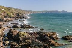 Looking across the beach at Whitesand Bay in Cornwall towards th. E Rame Head headland Stock Images