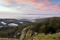 Looking across the English countryside on a winters sunrise, with mist lying in the valley below. From Raggedstone Hill on the Mal. Vern Hills looking across to stock images