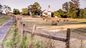 Looking across farm field to an old chapel near Victoria, BC Stock Photos