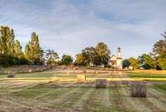 Looking across farm field to an old chapel near Victoria, BC Stock Image