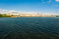 Looking across at a large hydroelectric dam and power station royalty free stock photo