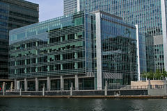 Looking across at modern waterside office. Looking across at modern waterside glass office Stock Images