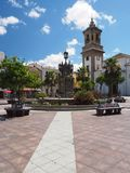 Looking across the Plaza Alta and the colorful tiled fountain and seating. To the Iglesia de Nuestra Senora de la Palma, or The Church of Our Lady of the Palm Royalty Free Stock Image
