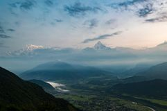 Looking across the Pokhara Valley to the Himalayas and Fish Tail Mountain from Sarangkot at sunrise.  stock photos