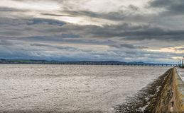 Looking Across the River Tay Dundee Towards the Rail Bridge in t. He Distance.dark Brooding skys on a December winters day at the Dundee Waterfront Stock Photo