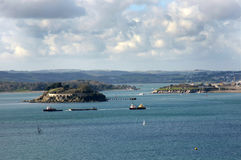 Looking across the Sound, Plymouth Devon UK. Looking towards the entrance to the river Tamar and Cornwall beyond.Drakes Island is to the left of the image and Royalty Free Stock Image