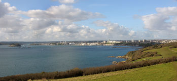 Looking across the Sound, Plymouth Devon UK. Looking towards the Hoe and the entrance to the river Tamar and Cornwall beyond.Drakes Island is to the left of the Stock Images