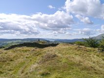 Looking across wall on Black Crag, to summit trig Stock Photos