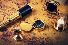 Looking for adventures concept - vintage navigation items. On old world map Royalty Free Stock Photography